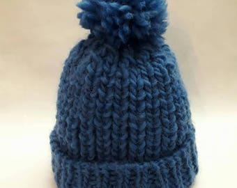 Warm winter blue pom pom hat made of soft wool yarn, hand knitted