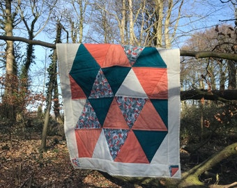 Tropical and contemporary this quilt will put a smile on your face!