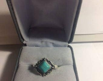 Silver band with turquoise stone
