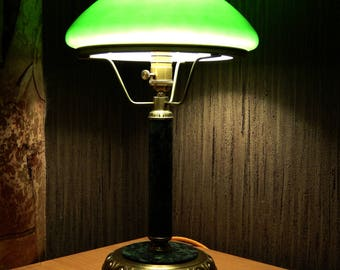 Table lamp with a green shade