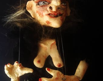 Marionette witch black cat