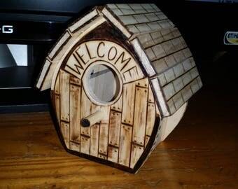 Litte wood burned bird house.