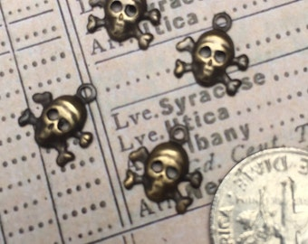Tiny Skull and Cross Bones Antiqued Brass Charms