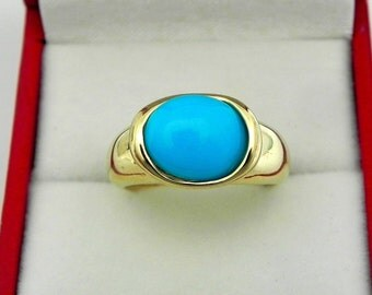 AAAA Sleeping Beauty Turquoise 2.28 carats  11x9mm in 14K Yellow gold bezel set ring.  0261