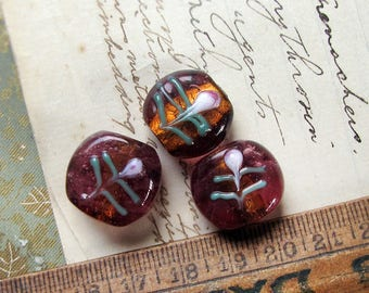 reserved ---- vintage chunky purple lampwork beads with metallic gold core and flower motif