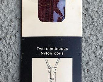 """9"""" wine Talon Zephyr skirt or neckline zipper - NYLON. Style 25-1. 1970s."""