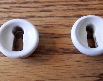 One (1) antique, key hole escutcheon, china, porcelain, furniture part
