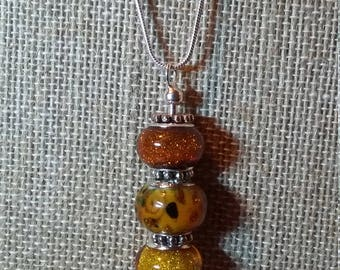 Pendant Necklace with Interchangeable Murano Style Glass Beads on 24 Inch Snake Chain, Amber and Floral