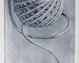 Original drypoint etching print of a ball of string yarn in soft smokey grey tones first in an edition of 15