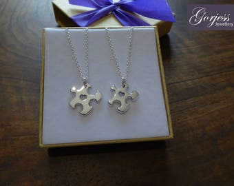 Two Miniature Puzzle Silver Pendants, one Thick and one Thin