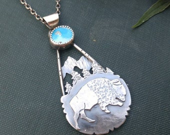 Sleeping Beauty Turquoise and Sterling Silver Bison Mountain Scene Pendant. Bison, American Buffalo, Evergreen Trees, Mountains, Wilderness.