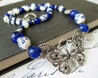 Silver Filigree Butterfly Necklace. Cobalt Blue and White Floral Chinoiserie Porcelain. Moonstone. Victorian Inspired. Beaded. Czech Glass.