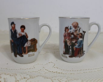"""Set of Two Norman Rockwell Mugs - """"The Toymaker"""" Mug and """"The Lighthouse Keeper's Daughter"""" - Pair of Norman Rockwell Museum Mugs"""