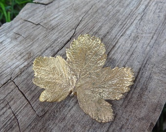 Gold tone autumn leaf