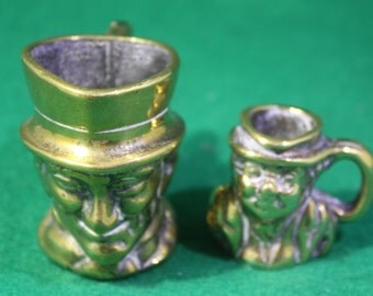Vintage pair of miniature solid brass Toby jugs Made in England.