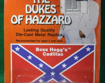 Vintage  NOS scarce 1 /64 scale Ertl  replica The Dukes of Hazzard Boss Hogg's  Cadillac #1567 Made in the USA