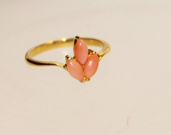 Pink coral ring mounted on plated gold
