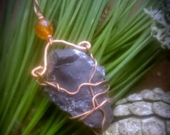 Shungite and amber copper wire wrapped pendant made in Bristol UK