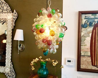 Light fixture of hand blown glass