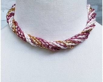 Pearl, purple and gold tone twist-a-bead with peach and gold tone shell clasp