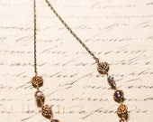 Purple, lilac and antique gold Maasai beadwork necklace.