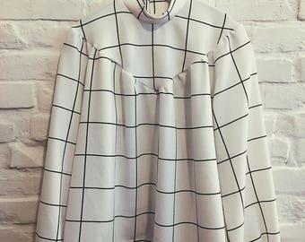 Button back blouse in minimalistic white check fabric