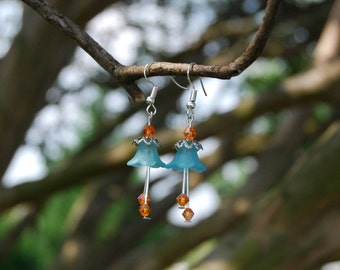 Bell Flower Earrings with Light Blue Bell Flower, Silver Flower Bead Cap, and Orange Bicone Crystal Beads. Nickel free earring hooks.