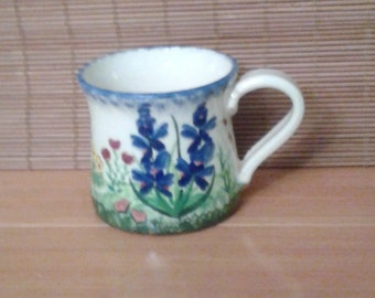 Handmade ceramic coffee cup with wildflowers, blue bonnets