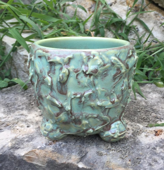 glossy turquoise and brown tea bowl with textured exterior
