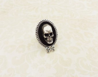 Iron skull adjustable cameo  ring , with velvet base,a  bow silvertone setting, gothic style