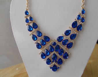 Gold Tone Bib Necklace with Blue Crystal Beads and Clear Rhinestones on a Gold Tone Chain