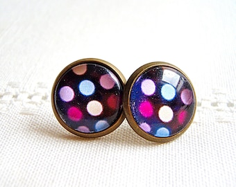 Earrings, studs pink and blue peas on a black background. Bronze and glass.