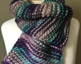 Hand knit scarf in Multi colored purples, teal, and grey