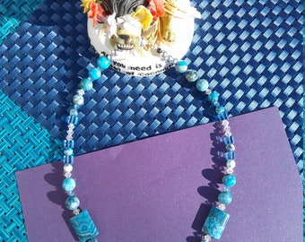 18 in necklace with multiple shapes and brilliant blue/turquoise colors