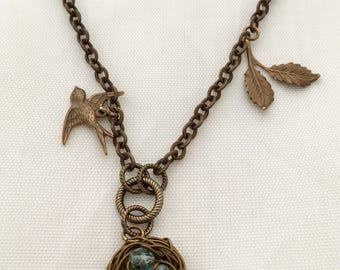 Brass bird nest necklace with Czech glass beads