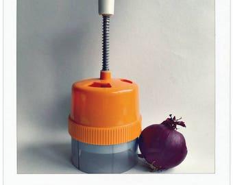 Vintage orange vegetable shaker named Gerda.