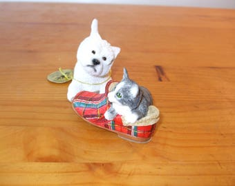 The Leonardo Collection Westie (West Highland Terrier) with cat and tartan slipper