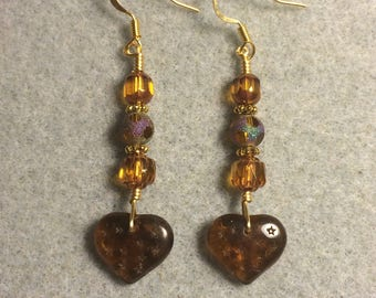 Dark amber Czech glass heart bead dangle earrings adorned with amber Czech glass beads.