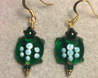 Dark green with blue spots lampwork turtle bead earrings adorned with dark green Chinese crystal beads.