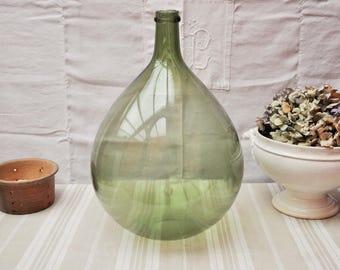 Antique demijohn green bottle . Dame Jeanne Glass Carboy .