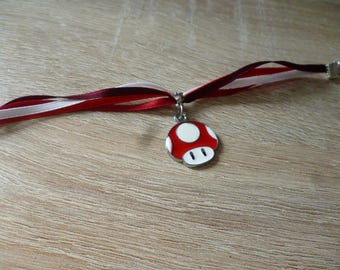 Bracelet composed of several ribbons with red Mario Mushroom - Red mushroom charm