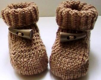 Beige acrylic baby shoes