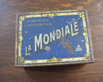 La Mondiale Impremerie Commerciale, blue metal box containing letters and numbers, punch holder and tweezer.