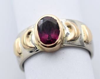 Celestial theme Eclipse wedding band in 14k White gold with yellow gold phases of the moon accents featuring beautiful oval Rhodolite garnet
