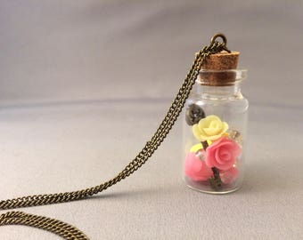 Pink and yellow glow in dark charm necklace, glow in the dark, dome necklace, beauty and the beast, handmade roses, unique