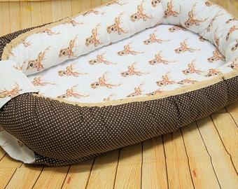 Sweet Nest/cocoon with deer head motif,
