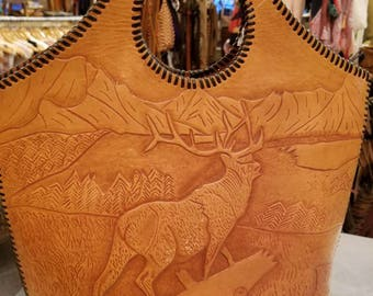 Vintage 70s tooled leather bag with whipstitch and bobcat deer mountain motif