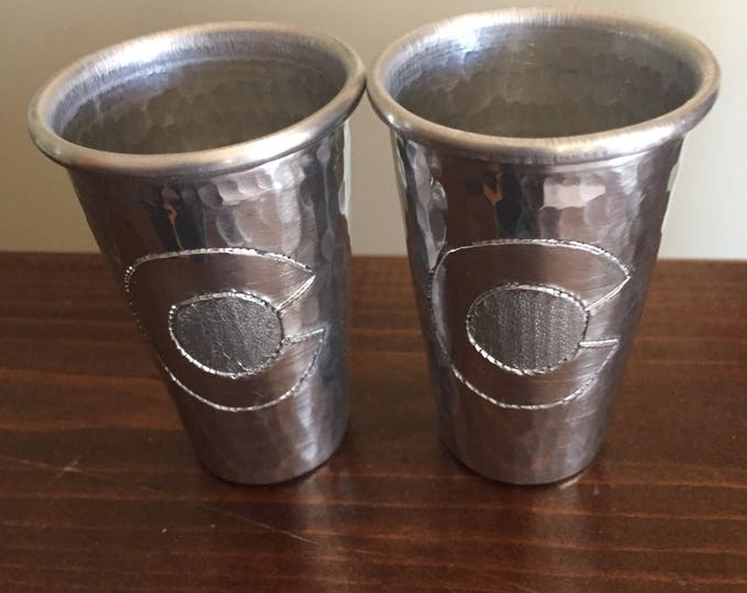 "2-pack of 2oz hammered aluminum shot glasses with Colorado ""C"" engraved"