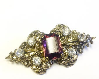 Vintage, purple rhinestone brooch.