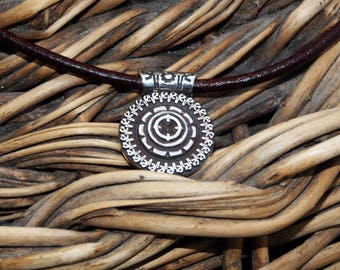 Pendant silver law MANDALA with Ruby cabochon of 4 mm